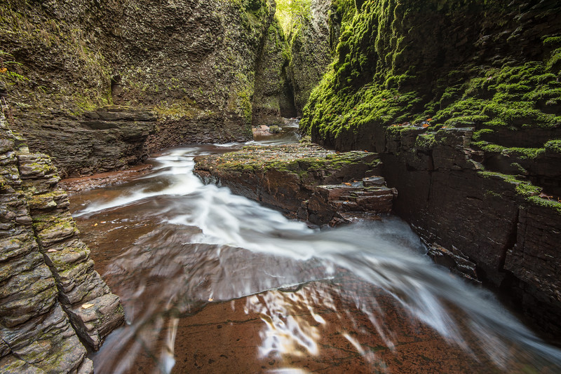 """FRIDAY, OCTOBER 16, 2015<br /> <br /> RIVERS 0699<br /> <br /> """"North Shore Slot Canyon""""<br /> <br /> Deep down in the narrowest part of the Kadunce River canyon.  This photo is from last month when I was exploring the many waterfalls of the river.  It sure is a fun place to spend time with a camera!  This is looking downstream at the narrowest part of the canyon, where one can stretch their arms out and almost touch both sides of the canyon at the same time.  <br /> <br /> Camera: Nikon D750<br /> Lens: Nikon 16-35mm f/4<br /> Focal length: 16mm<br /> Shutter speed: 5 seconds<br /> Aperture: f/16<br /> ISO: 100"""