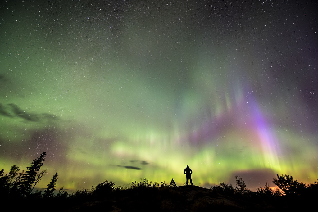 """SUNDAY, SEPTEMBER 20, 2015<br /> <br /> AURORA 0546<br /> <br /> """"Admiring the Aurora Borealis""""<br /> <br /> Another photo from last night's aurora borealis (northern lights) storm.  This photograph was made at 4:50 AM in Grand Portage, MN.  It's another """"self-portrait"""" where I set the timer on the camera then walked up onto this rock to silhouette myself against the lights in the sky.<br /> <br /> Camera: Nikon D750<br /> Lens: Nikon 14-24mm f/2.8<br /> Focal length: 14mm<br /> Shutter speed: 25 seconds<br /> Aperture: f/2.8<br /> ISO: 1600"""
