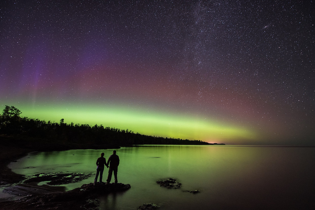 "WEDNESDAY, SEPTEMBER 9, 2015<br /> <br /> AURORA 9854<br /> <br /> ""Aurora Watching at Gooseberry Falls State Park""<br /> <br /> A nice show of northern lights early last night along the Lake Superior shoreline at Gooseberry Falls State Park.  It was the perfect ending to a fun afternoon of biking the Gichi Gami Trail and a delicious BBQ dinner at Camp 61 in Beaver Bay.  We have since heard that the lights became more active later in the night but after our 26 mile bike ride we didn't feel like staying up too late.  What we saw was plenty beautiful and a great way to spend the last hour and a half of the day before crawling into the tent for the night!<br /> <br /> Camera: Nikon D750<br /> Lens: Nikon 14-24mm f/2.8<br /> Focal length: 14mm<br /> Shutter speed: 30 seconds<br /> Aperture: f/2.8<br /> ISO: 1600"