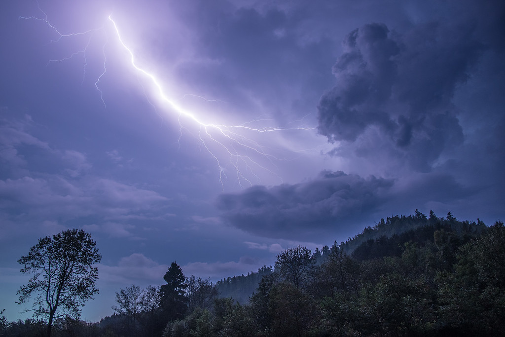 """SUNDAY, SEPTEMBER 6, 2015<br /> <br /> LIGHTNING 9579<br /> <br /> """"Electric Sky over Mt. Rose""""<br /> <br /> We had quite a nice lightning show last night!  It was one of those rare times when lightning was flashing all around the sky but there wasn't any rain falling (although it did start raining after most of the lightning had passed us by).  It also was not windy at all.  Last but not least, most of the lightning was up in the sky and not making any apparent ground connection.  I made this photograph looking at the summit of Mt. Rose in Grand Portage National Monument.<br /> <br /> Camera: Nikon D750<br /> Lens: Nikon 24-120mm f/4<br /> Focal length: 24mm<br /> Shutter speed: 12 seconds<br /> Aperture: f/5.6<br /> ISO: 400"""