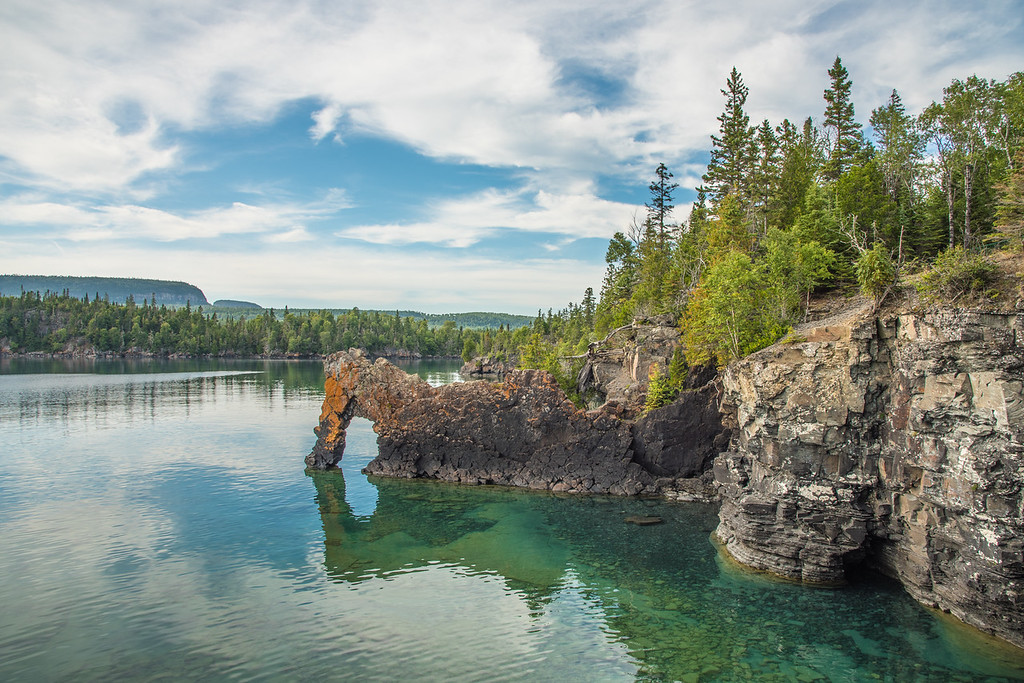"SUNDAY, SEPTEMBER 6, 2015<br /> <br /> ONTARIO 9393<br /> <br /> ""The Sea Lion""<br /> <br /> Sleeping Giant Provincial Park - Ontario, Canada<br /> <br /> No trip to Sleeping Giant Provincial Park would be complete without a short hike to the Sea Lion, a rock arch on the Lake Superior shoreline.  The Sea Lion is one of the most famous features of the park.  The arch was the last stop on our 22 kilometer round-trip bike/hike to the Top of the Giant, but if all you want to see is the arch, it is a relatively short hike (just over one kilometer) from the Kabeyun Trail parking lot.  I love this park and I can't wait to explore more of it!<br /> <br /> Camera: Nikon D750<br /> Lens: Nikon 24-120mm f/4<br /> Focal length: 24mm<br /> Shutter speed: 1/160<br /> Aperture: f/11<br /> ISO: 100"