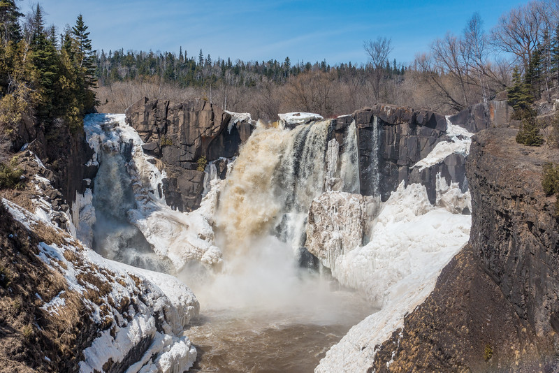 "SATURDAY, APRIL 16, 2016<br /> <br /> PIGEON RIVER 09643<br /> <br /> ""High Falls - April 15, 2016""<br /> <br /> Grand Portage State Park - High Falls update:<br /> <br /> High Falls is now running freely! The majority of the ice on the river has now broken up and with weekend temperatures forecast to be in the upper 50's it could be a weekend for big changes in water volume. There is still close to 2 feet of snow cover in the forest along the upper half of the river. As the snow begins to melt more rapidly with the warmer temperatures we are experiencing it should equate to even more impressive views of the falls!<br /> <br /> Camera: Sony DSC-RX100M3<br /> Focal length: 46mm<br /> Shutter speed: 1/800<br /> Aperture: f/7.1<br /> ISO: 200"
