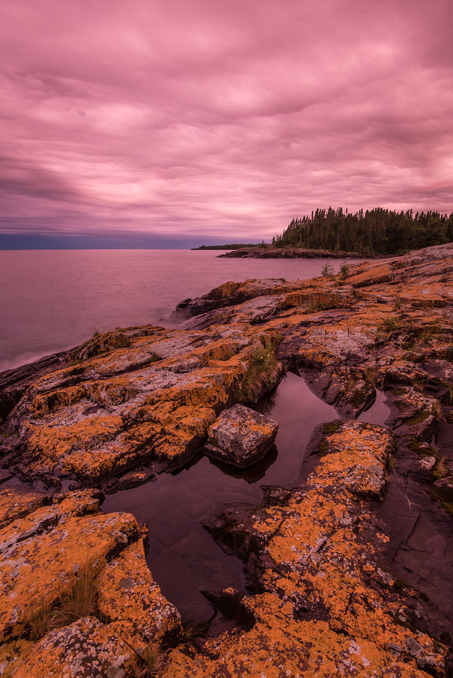 "FRIDAY, AUGUST 12, 2016<br /> <br /> SUPERIOR SUMMER 9312<br /> <br /> ""Surreal Sky - A Lake Superior Fantasy""<br /> <br /> Wow.... what else can I say?  The evening of August 10, 2016 had one of the most unique transitions from day to dusk that I've ever witnessed.  For the latter part of the afternoon and evening we had pretty thick cloud cover and it was basically a monotone type of day.  Everything was just gray.  As sunset approached, however, the cloud cover must have gotten thinner because all of a sudden everything got brighter and the sky took on this really strange glow with some of the most unbelievable, surreal colors that I've ever seen.  <br /> <br /> I was reluctant to post the picture you see here because I didn't think anyone would believe that it's real.  But, it is what my camera saw.  There is no photoshop trickery involved here, this is what the sky looked like.  There were also no filters at all used in the creation of this image, and it was shot on auto white balance which, if anything, usually produces images with a cooler color tone.  I literally do not remember ever seeing sky color quite like this before.  It sure made for a dramatic end to the day!<br /> <br /> Camera: Nikon D750<br /> Lens: Nikon 16-35mm f/4<br /> Focal length: 16mm<br /> Shutter speed:  4 seconds<br /> Aperture: f/11<br /> ISO: 200"