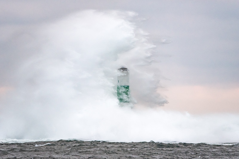 "TUESDAY, JANUARY 12, 2016<br /> <br /> SUPERIOR WAVES 6002<br /> <br /> ""Wave Explosion""<br /> <br /> It seems like the lighthouse gets all the attention when it comes to photos of waves hitting the break walls in Grand Marais.  While it does tend to make more interesting photos than the beacon light on the other side of the harbor entrance, sometimes the waves are hitting harder on the beacon.  Such was the case on this day, when it seemed every other wave hit with explosive force.  I really liked this shot, where I caught the spray dissipating after the main wave impact.  I like how the beacon seems to be peeking out from within the cloud of spray.<br /> <br /> Camera: Nikon D750<br /> Lens: Tamron SP 150-600mm<br /> Focal length: 460mm<br /> Shutter speed: 1/800<br /> Aperture: f/8<br /> ISO: 3200"