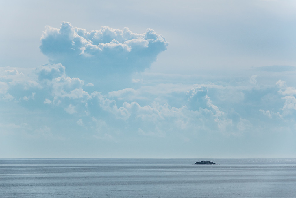 "WEDNESDAY, JULY 27, 2016<br /> <br /> SUPERIOR SUMMER 00515<br /> <br /> ""Summer Clouds over Five Mile Rock""<br /> <br /> Yesterday there were some really clouds out over the horizon of Lake Superior.  As I drove towards Grand Marais I kept glancing at the clouds and eventually I had to stop and make some photographs of them.  I knew it would make for a more interesting shot with Five Mile Rock in the foreground, so that's where I decided to stop and make this photo.<br /> <br /> Camera: Sony DSC-RX10M3<br /> Focal length: 229mm<br /> Shutter speed: 1/1000<br /> Aperture: f/6.3<br /> ISO: 100"
