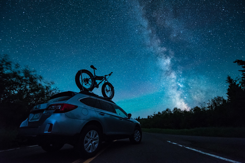 "MONDAY, JULY 4, 2016<br /> <br /> MILKY WAY 8736<br /> <br /> ""Night Sky Adventure Seeker""<br /> <br /> What a great weekend it's been for the Milky Way!  Here's a shot from the other night when I was out driving around looking for photos to make of the night sky.  Last week I traded in my F-150 for a more well-rounded and versatile vehicle, a Subaru Outback.  I loved the truck, but I already love the Outback more.  It does almost everything the truck did and some things the truck couldn't do, such as achieve highway MPG's in the mid to upper 30's.  I'm looking forward to lots of photographic adventures that this vehicle is sure to take me on! <br /> <br /> Camera: Nikon D750<br /> Lens: Nikon 14-24mm f/2.8<br /> Focal length: 14mm<br /> Shutter speed: 30 seconds<br /> Aperture: f/2.8<br /> ISO: 6400"