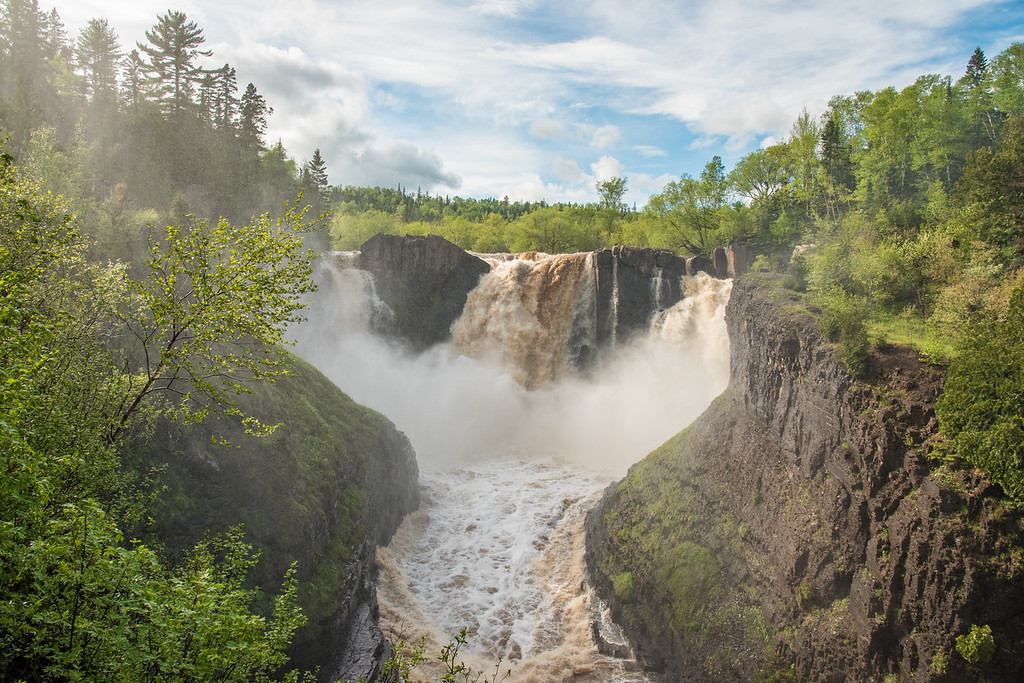 "TUESDAY, JUNE 7, 2016<br /> <br /> PIGEON RIVER 8041<br /> <br /> ""After the Rain - High Falls of the Pigeon River""<br /> <br /> A couple inches of rain fell over the weekend and all of the rivers along Minnesota's north shore of Lake Superior are swollen with run-off!  High Falls of the Pigeon River in Grand Portage State Park is especially dramatic when the water is so high.  The river rose almost 4 feet as a result of the rain!  If you visit on a sunny day you'll be sure to get an awesome view of a rainbow in the mist of the waterfall!<br /> <br /> Camera: Nikon D750<br /> Lens: Nikon 24-120mm f/4<br /> Focal length: 24mm<br /> Shutter speed: 1/400<br /> Aperture: f/11<br /> ISO: 400"