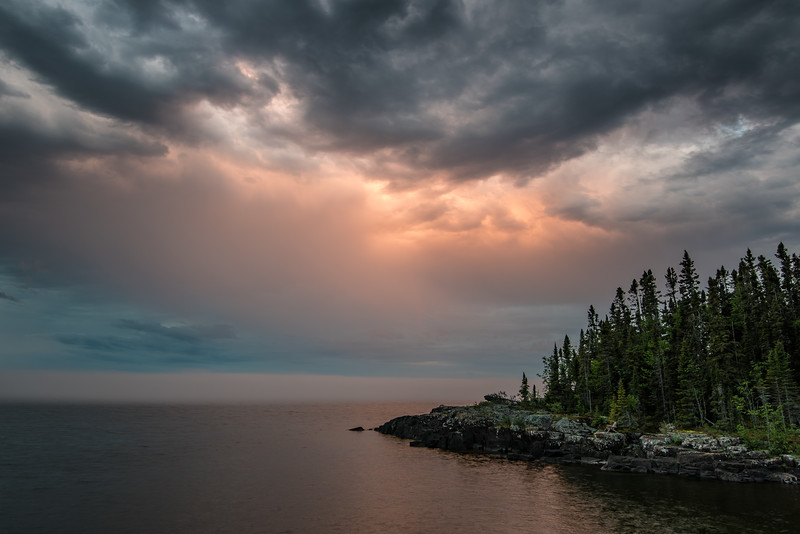 "FRIDAY, JUNE 24, 2016<br /> <br /> SUPERIOR SUMMER 8218<br /> <br /> ""Sunset Storm""<br /> <br /> <br /> A recent stormy sunset over Lake Superior in Grand Portage, MN.  It had been nice weather all day but in the evening a storm front moved in and it got pretty windy and rained off and on all night.  It was beautiful again the next day.  I love when the weather patterns move like that :-)<br /> <br /> Camera: Nikon D750<br /> Lens: Nikon 16-35mm f/4<br /> Focal length: 19mm<br /> Shutter speed: 1 second<br /> Aperture: f/11<br /> ISO: 100"
