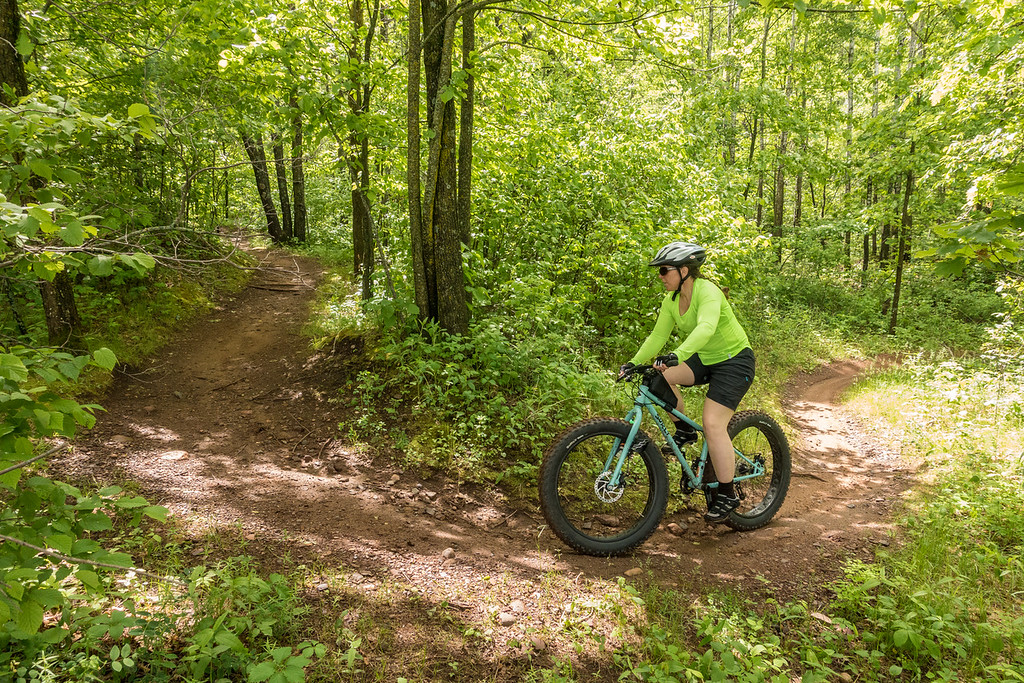 FRIDAY, JUNE 3, 2016<br /> <br /> BIKING 00537<br /> <br /> Jessica cruising the curves of the Little Sidewinder Trail.<br /> <br /> Cuyuna Country State Recreation Area - Crosby/Ironton, MN<br /> <br /> Camera: Sony DSC-RX100M3<br /> Focal length: 24mm<br /> Shutter speed: 1/800<br /> Aperture: f/4.5<br /> ISO: 1000