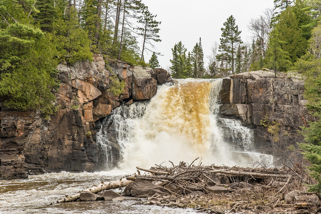 """FRIDAY, MAY 13, 2016<br /> <br /> ONTARIO 7927<br /> <br /> """"Arrow River Waterfall""""<br /> <br /> We had a busy weekend this past week!  We went for a cross bike ride on the eve of the beginning of our weekend, then spent the following morning doing yard work.  After a quick lunch we hiked up Mt. Josephine, one of the most rugged and challenging hikes along the entire Minnesota north shore.  The next day we started off with a morning fat bike ride then in the afternoon we went up into Canada and hiked to this waterfall on the Arrow River.  <br /> <br /> This waterfall is only a 25 mile drive from our house followed by about a one mile hike through the woods.  There is no established trail to this waterfall.  I visited it for the first time last fall, despite it being not that far from home.  It is a beautiful waterfall.  The Arrow River flows into the Pigeon River, which flows through the state park where I work.  Visiting the waterfall was a great way to wrap up our fun weekend.  Oh, we went to work the next day then did another cross bike ride in the evening after work :-)  <br /> <br /> In case you haven't already heard, Jessica deserves some congratulations!  She applied for a job at Sequoia National Park and was recently offered the job!  It's quite a step up from her position here, and is a job with a 3-month furlough so she will be coming back home to Minnesota during those 3 months.  It'll be tough to be apart for so long, but it's a temporary change, one that will help advance her career and help her retirement plus be very challenging and rewarding.  And, it'll be a great excuse for me to use some vacation time to go out and see her and explore more of California with her :-)  In the meantime, we plan on filling as much of our time as possible with lots of outdoor adventures before she leaves for California!<br /> <br /> Camera: Nikon D750<br /> Lens: Nikon 24-120mm f/4<br /> Focal length: 105mm<br /> Shutter speed: 1/250<br /> Aperture: f/10<br /> ISO: 160"""
