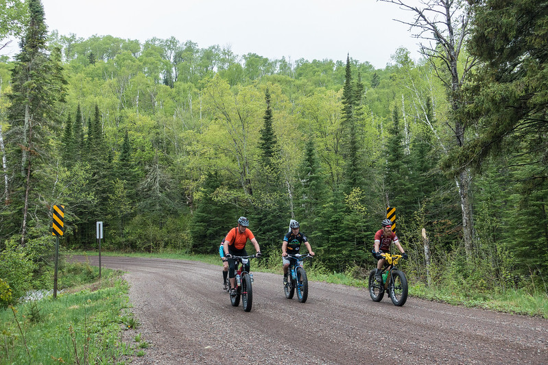 "SUNDAY, MAY 29, 2016<br /> <br /> BIKING 00483<br /> <br /> ""Le Grand du Nord - May 28, 2016""<br /> <br /> The Cook County fat bike crew... John Twiest, Adam Harju and Jay Arrowsmith DeCoux on Trout Lake Road.<br /> <br /> Camera: Sony DSC-RX100M3<br /> Focal length: 39mm<br /> Shutter speed: 1/500<br /> Aperture: f/4<br /> ISO: 800"