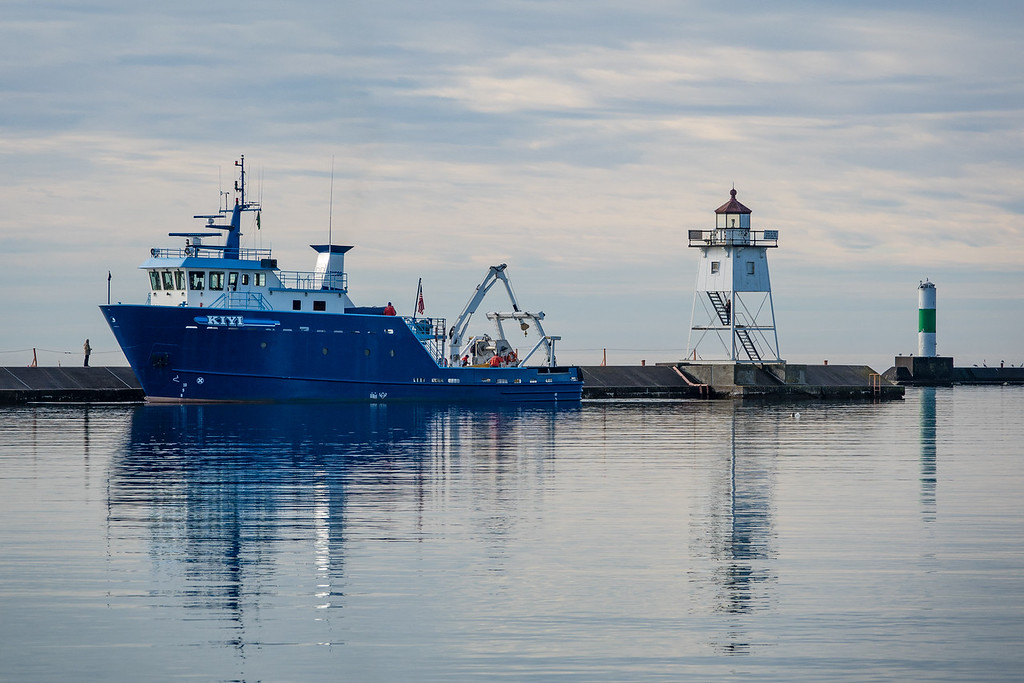 "THURSDAY, NOVEMBER 17, 2016<br /> <br /> SUPERIOR BOATS 03347<br /> <br /> ""R/V Kiyi - Grand Marais Harbor""<br /> <br /> Yesterday I had to bring a relative to the airport in Duluth and along the way we were lucky enough to see the research vessel Kiyi departing the Grand Marais harbor just as we were passing through town.  The R/V Kiyi is based in Ashland, Wisconsin and conducts fish stock assessment, fisheries research and habitat monitoring.  She was built in 1999 and has a length of 107 feet.  She sure is a beautiful ship!<br /> <br /> Camera: Sony DSC-RX10M3<br /> Focal length: 221mm<br /> Shutter speed: 1/800<br /> Aperture: f/4<br /> ISO: 100"