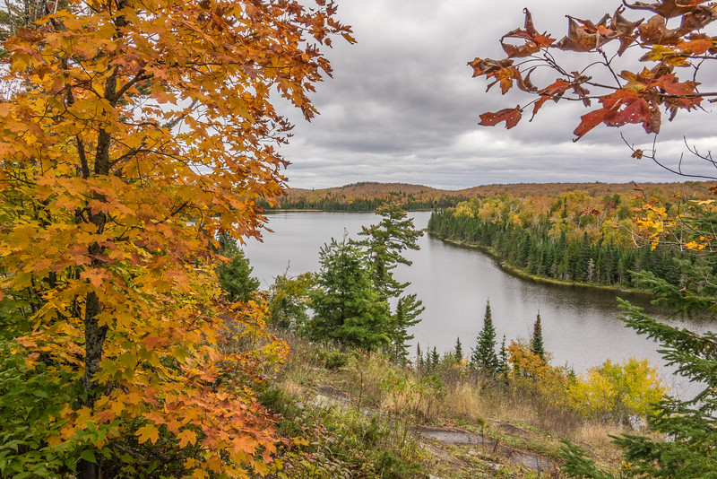 """TUESDAY, OCTOBER 4, 2016<br /> <br /> AUTUMN 01320<br /> <br /> """"Fall Colors, Lake Agnes""""<br /> <br /> A photo from an outing on the Superior Hiking Trail in Lutsen, MN on the section of the SHT between the Caribou Trail and Lutsen Mountains.  Lake Agnes is a beautiful little lake surrounded by the colors of autumn.  Hiking this section of trail is a very nice way to spend a late September afternoon!<br /> <br /> Camera: Sony DSC-RX10M3<br /> Focal length: 24mm<br /> Shutter speed: 1/100<br /> Aperture: f/8<br /> ISO: 100"""