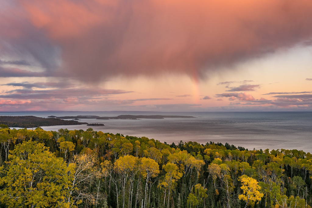 "SUNDAY, OCTOBER 9, 2016<br /> <br /> SUPERIOR FALL 01878<br /> <br /> ""Autumn Sunset Squall, Susie Islands""<br /> <br /> A beautiful view of a sunset rain squall, rainbow and fall colors over the Susie Islands last night on my way home from work.  I feel so fortunate to be able to capture photos like this on my way to and from work!  To top things off, I could hear two bald eagles calling to each other down along the shoreline.  It was the perfect ending to the day.<br /> <br /> Camera: Sony DSC-RX10M3<br /> Focal length: 35mm<br /> Shutter speed: 1/60<br /> Aperture: f/4<br /> ISO: 100"