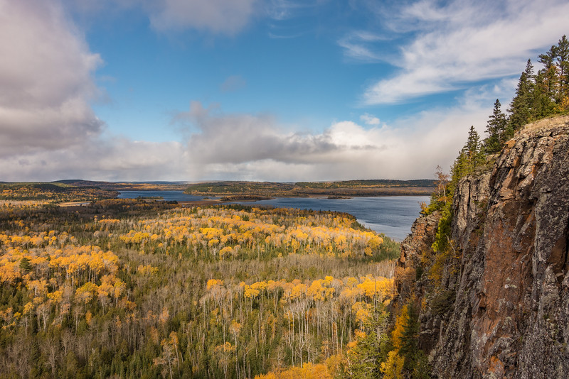 """SATURDAY, OCTOBER 15, 2016<br /> <br /> AUTUMN 04177<br /> <br /> """"Late Autumn Colors, South and North Fowl Lakes""""<br /> <br /> On my second day off this week I met up with my friend and fellow photographer Bryan Hansel and we went on a fun hiking/biking adventure.  We hiked 7.5 miles of the Border Route Trail then rode our fat bikes 7.5 miles back to our vehicles via some gravel county roads.  On the hiking portion of our adventure we passed by several awesome overlooks of South and North Fowl Lakes, which are the direct source of the Pigeon River.  This photo makes it look like a really nice day (which it was at times) but it was actually pretty cold, windy and a few times throughout the day there were even snow flurries.  It was a typical mid-October day :-)<br /> <br /> Camera: Sony DSC-RX100M3<br /> Focal length: 24mm<br /> Shutter speed: 1/1250<br /> Aperture: f/4<br /> ISO: 100"""