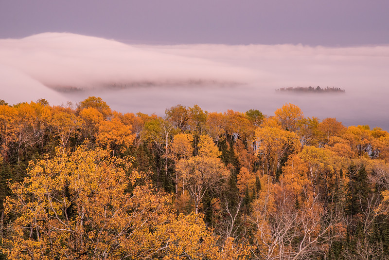 "SUNDAY, OCTOBER 16, 2016<br /> <br /> SUPERIOR FALL 0745<br /> <br /> ""Fall Colors and Lake Superior Fog""<br /> <br /> Here is another photo from sunset last night.  This photo is looking to the east over Lake Superior and the Susie Islands in Grand Portage, MN.  The fog last night was so beautiful.  It's a little unusual to see so much fog on the lake this time of year. The combination of the fog and fall colors makes for a nice photo!  <br /> <br /> Camera: Nikon D750<br /> Lens: Nikon 24-120mm f/4<br /> Focal length: 120mm<br /> Shutter speed: 1 second<br /> Aperture: f/11<br /> ISO: 400"