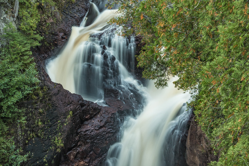 "SATURDAY, OCTOBER 1, 2016<br /> <br /> RIVERS 03670<br /> <br /> ""The Devil's Kettle Waterfall""<br /> <br /> Here's a recent photo of the Devil's Kettle waterfall in Judge C.R. Magney State Park, located roughly halfway between Grand Marais and Grand Portage, MN.  This waterfall is really unique in that it splits into two channels and one of the channels (the one on the left in this photo) plunges into a hole in the rock and nobody knows where it comes back out.  The channel on the right drops into a pool and continues to flow downstream.  It is a curious and fascinating thing to ponder, where that hole in the rock goes and where the water that drops into it ends up.<br /> <br /> Camera: Sony DSC-RX100M3<br /> Focal length: 70mm<br /> Shutter speed: 0.8 seconds<br /> Aperture: f/11<br /> ISO: 80"