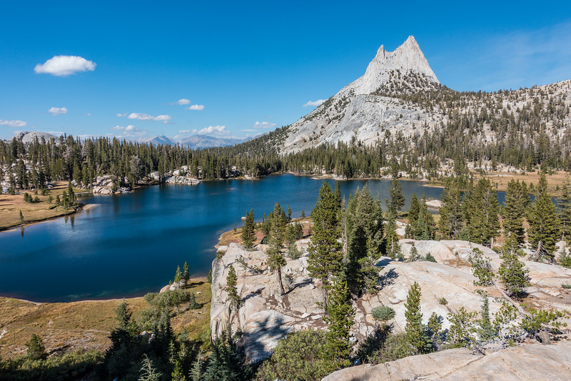 "SUNDAY, SEPTEMBER 25, 2016<br /> <br /> CALIFORNIA 03484<br /> <br /> ""Cathedral Peak and Upper Cathedral Lake""<br /> <br /> Yosemite National Park<br /> <br /> Our next stop after a night of rest and recuperation in the town of Bishop was the high country of Yosemite National Park.  We camped at the Tuolumne Meadows campground and hiked up to Cathedral Lakes.  This hike was unbelievable!  Talk about a quintessential Sierra mountain scene!  We first hiked to Lower Cathedral Lake which, of course, was plenty beautiful but I much preferred Upper Cathedral Lake.  The views from the far side of Upper Cathedral Lake were awesome, to say the least.  <br /> <br /> The upper lake has a rock hillside on the opposite side of the lake from Cathedral Peak.  When you climb up this hillside you get an incredible view of the lake with Cathedral Peak behind it.  It was one of the best views I've ever seen.  Ever.  I felt like I could sit there forever and never tire of the view.  We lingered for a while on the shoreline of the lake after taking in the view from the hillside, but then it was time to go.  We had to get going if we wanted to make it back to our campsite before nightfall.  On a future trip I really want to camp here with Jessica and take in the sunset/night sky/sunrise views with her.  That will be even more awesome :-)  <br /> <br /> Camera: Sony DSC-RX100M3<br /> Focal length: 24mm<br /> Shutter speed: 1/800<br /> Aperture: f/5.0<br /> ISO: 100"