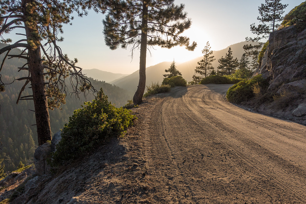 "WEDNESDAY, SEPTEMBER 21, 2016<br /> <br /> CALIFORNIA 02836<br /> <br /> ""Sunset, Mineral King Road""<br /> <br /> A view of the stunning scenery along Mineral King Road in Sequoia National Park.  After visiting Black Wolf Falls and the NPS corral, the sun was just beginning to set behind the mountains as we drove back down the road to Jessica's cabin.  Hard to believe that she gets to see this view twice a day on her short drive to and from work.  What a lucky duck :-)<br /> <br /> Camera: Sony DSC-RX100M3<br /> Focal length: 24mm<br /> Shutter speed: 1/800<br /> Aperture: f/4<br /> ISO: 100"