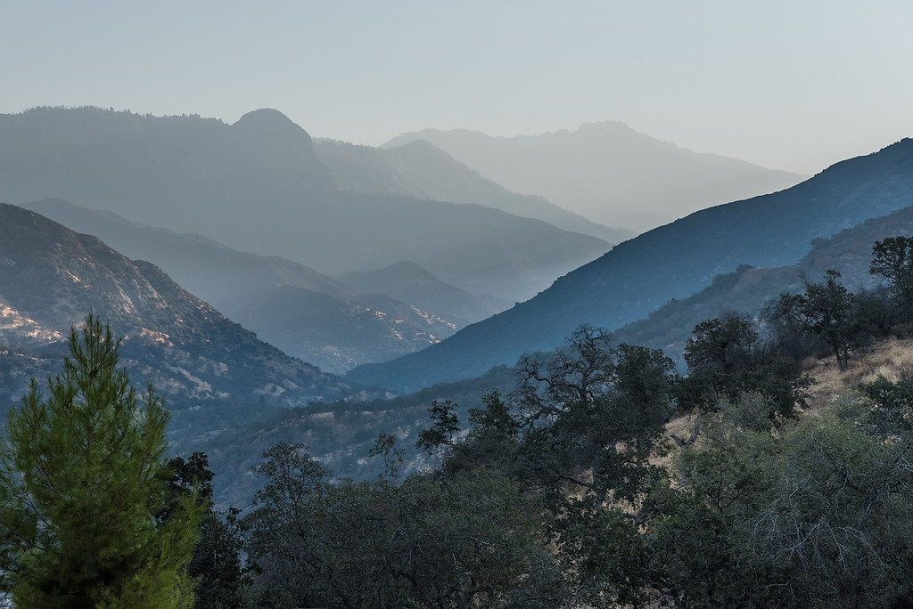 "SUNDAY, SEPTEMBER 18, 2016<br /> <br /> CALIFORNIA 9761<br /> <br /> ""The Hazy Mountains of California""<br /> <br /> I just returned from a 10-day trip to California to visit my wife Jessica, who is working at Sequoia National Park.  She took some vacation time as well and we did some traveling around the Sierra region.  We camped most of the time and did a lot of hiking.  The day I arrived the air quality wasn't the best and as we drove up into Sequoia National Park the haze made me think of the Smoky Mountains out east.  The haze may not have been the best for breathing or visibility, but it sure made for some interesting photographs!<br /> <br /> I just returned from a 10-day trip to California to visit my wife Jessica, who is working at Sequoia National Park.  She took some vacation time as well and we did some traveling around the Sierra region.  We camped most of the time and did a lot of hiking.  The day I arrived the air quality wasn't the best and as we drove up into Sequoia National Park the haze made me think of the Smoky Mountains out east.  The haze may not have been the best for breathing or visibility, but it sure made for some interesting photographs!<br /> <br /> Camera: Nikon D750<br /> Lens: Nikon 24-120mm f/4<br /> Focal length: 82mm<br /> Shutter speed:  1/1250<br /> Aperture: f/11<br /> ISO: 400"