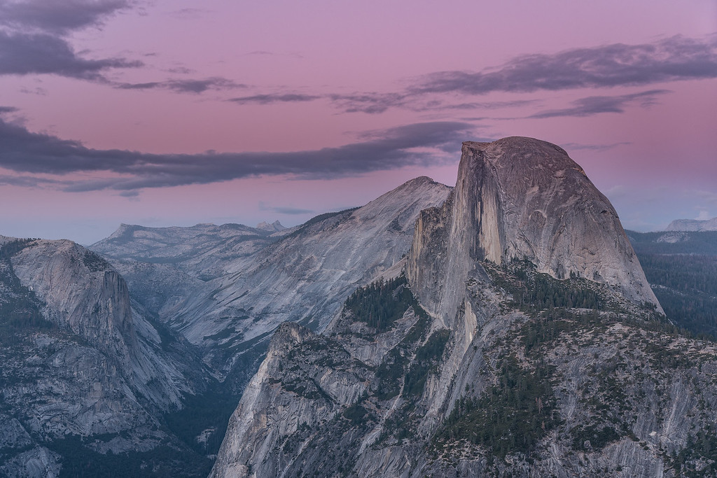 "THURSDAY, SEPTEMBER 29, 2016<br /> <br /> CALIFORNIA 0064<br /> <br /> ""Magic Hour Light over Half Dome""<br /> <br /> What could be a more fitting end to an awesome trip to California than enjoying the beautiful glow of magic hour light on Half Dome in Yosemite National Park with my beautiful wife at my side?  I can't think of a better way to end the trip.  I really didn't want to come home and ever since I got back all I can think about is going out there again!  I have definitely been bitten by the California bug :-)<br /> <br /> Camera: Nikon D750<br /> Lens: Nikon 24-120mm f/4<br /> Focal length: 58mm<br /> Shutter speed:  0.5 seconds<br /> Aperture: f/8<br /> ISO: 100"