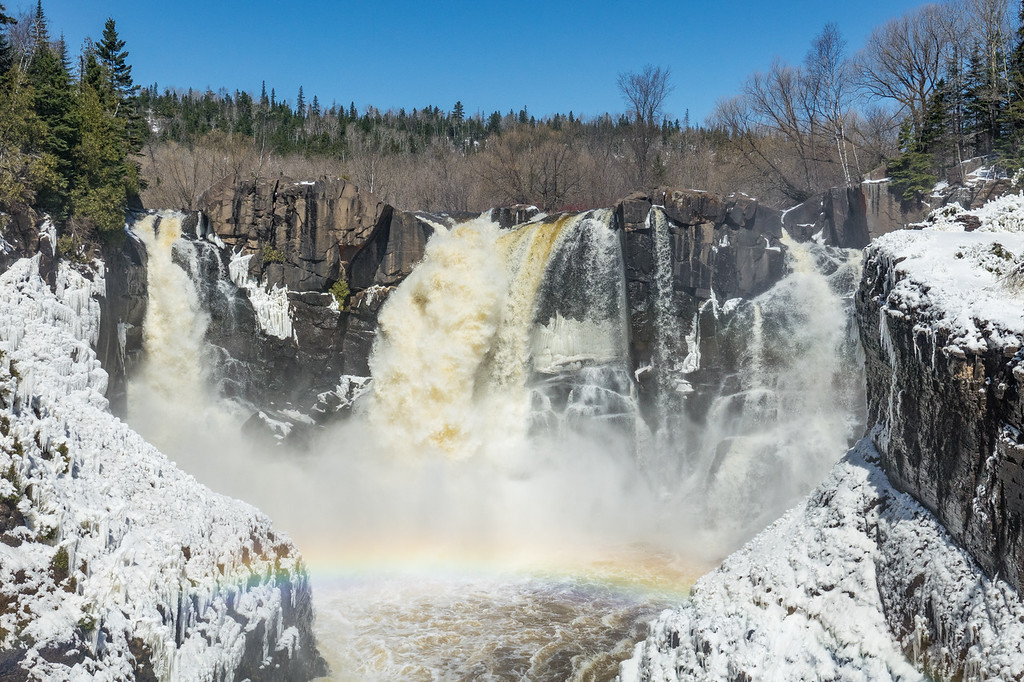 "SATURDAY, APRIL 29, 2017<br /> <br /> PIGEON RIVER 03869<br /> <br /> ""Spring at High Falls""<br /> <br /> The conditions at High Falls were awesome today.  Snow and ice, blue sky and a rainbow! Grand Portage State Park, MN.<br /> <br /> Camera: Sony DSC-RX10M3<br /> Focal Length: 44mm<br /> Exposure Time: 1/1600<br /> Aperture: f/5.6<br /> ISO: 200"