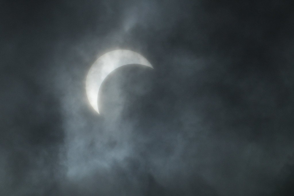 "WEDNESDAY, AUGUST 30, 2017<br /> <br /> MOONLIGHT 05187<br /> <br /> ""The Great American Solar Eclipse""<br /> <br /> Yes, I photographed The Great American Eclipse too.  We almost missed it here in northeast Minnesota as our skies got really cloudy just as the eclipse was reaching its maximum for us (right about the time this photo was taken).  Clouds were moving quickly across the sun/moon combination and every now and then the eclipse was visible through an opening in the clouds.<br /> <br /> Camera: Sony DSC-RX10M3<br /> Focal Length: 600mm<br /> Exposure Time: 1/1250<br /> Aperture: f/16<br /> ISO: 80"