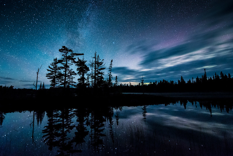 "AUGUST 12, 2017<br /> <br /> MILKY WAY 9789<br /> <br /> ""Nocturnal Northwoods Paradise""<br /> <br /> A little hint of Aurora Borealis meets with the Milky Way over Esther Lake in Grand Portage State Forest, Minnesota.  We are so fortunate to have such magnificent views of the night sky in the northeast corner of the state.  <br /> <br /> Camera: Nikon D750<br /> Lens: Nikon 14-24mm f/2.8<br /> Focal Length: 14mm<br /> Exposure Time: 30 seconds<br /> Aperture: f/2.8<br /> ISO: 6400"