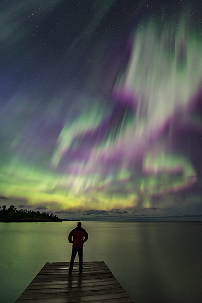 """FRIDAY, AUGUST 4, 2017<br /> <br /> AURORA 6417<br /> <br /> """"In awe of the storm""""<br /> <br /> I was digging through my archives again last night and came across another photo from June 2015 that I wanted to share.  This aurora event was by far one of the best I've ever seen.  The lights were everywhere in the sky that night.  This photo was taken at Hollow Rock Resort in Grand Portage, MN looking East over Lake Superior. According to  <a href=""""http://www.spaceweather.com"""">http://www.spaceweather.com</a> there is an 80% chance of geomagnetic storming today, August 4th, due to a solar wind stream that is expected to hit Earth's magnetic field.  High latitude sky watchers should be alert for auroras as night arrives on August 4th!<br /> <br /> Camera: Nikon D750<br /> Lens: Nikon 14-24mm f/2.8<br /> Focal Length: 14mm<br /> Exposure Time: 10 seconds<br /> Aperture: f/2.8<br /> ISO: 1600"""