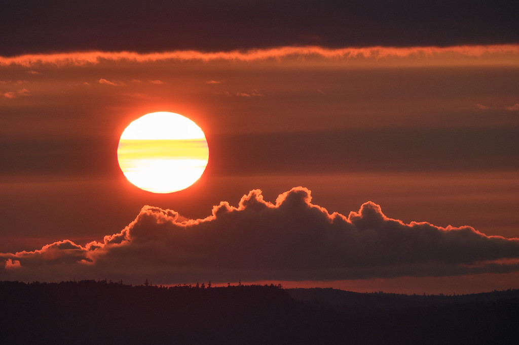 "THURSDAY, AUGUST 31, 2017<br /> <br /> FOREST 05199<br /> <br /> ""Fireball Sunset""<br /> <br /> I love what 600mm does for a sunset photo.  This was taken from the top of a fire tower in Grand Portage, MN.  A beautiful end to a beautiful day.<br /> <br /> Camera: Sony DSC-RX10M3<br /> Focal Length: 600mm<br /> Exposure Time: 1/800<br /> Aperture: f/5.6<br /> ISO: 200"