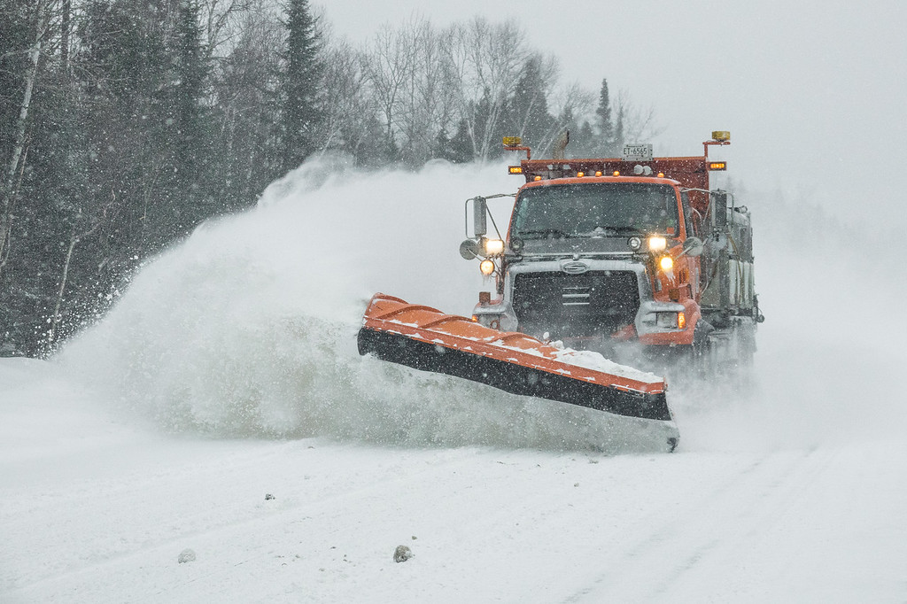 "SUNDAY, FEBRUARY 12, 2017<br /> <br /> TRANSPORTATION 00570<br /> <br /> ""MNDOT Blizzard Buster""<br /> <br /> We've received quite a bit of new snow in the past week and our local plow crews have been out diligently keeping the roads clear for us.  I don't really know why but I love taking pictures of the plow trucks in action!  The orange trucks are state trucks (MN Department of Transportation) and the yellow trucks are county (Cook County Highway Department).  Both do an excellent job taking care of our roads during these snow events!<br /> <br /> Camera: Sony DSC-RX10M3<br /> Focal Length: 79mm<br /> Exposure Time: 1/1600<br /> Aperture: f/4<br /> ISO: 800"