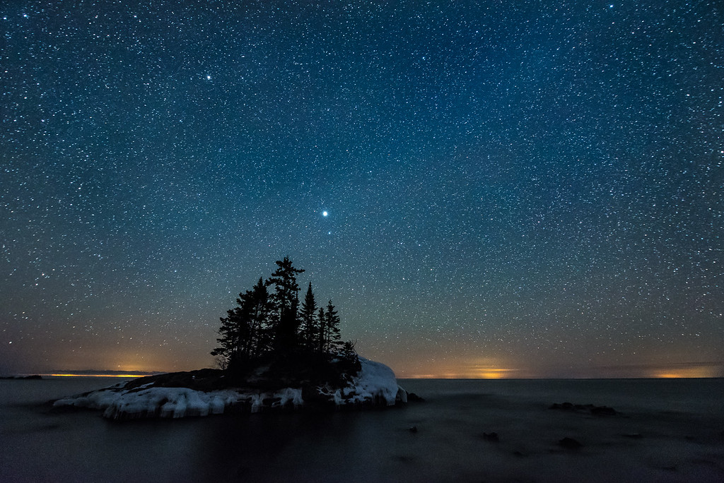 "MONDAY, FEBRUARY 27, 2017<br /> <br /> MILKY WAY 2031<br /> <br /> ""February Stars and Lake Superior""<br /> <br /> The stars were amazing last night!  So was the light pollution from the south shore of Lake Superior.  For some reason, last night cities on the south shore of the lake were casting a very bright glow on the horizon.  The glow was bright enough to easily see with the naked eye.  I don't think I've ever seen these lights show up so prominently.  I kind of like the effect it adds to this photo though.  <br /> <br /> Camera: Nikon D750<br /> Lens: Nikon 14-24mm f/2.8<br /> Focal Length: 14mm<br /> Exposure Time: 30 seconds<br /> Aperture: f/2.8<br /> ISO: 6400"