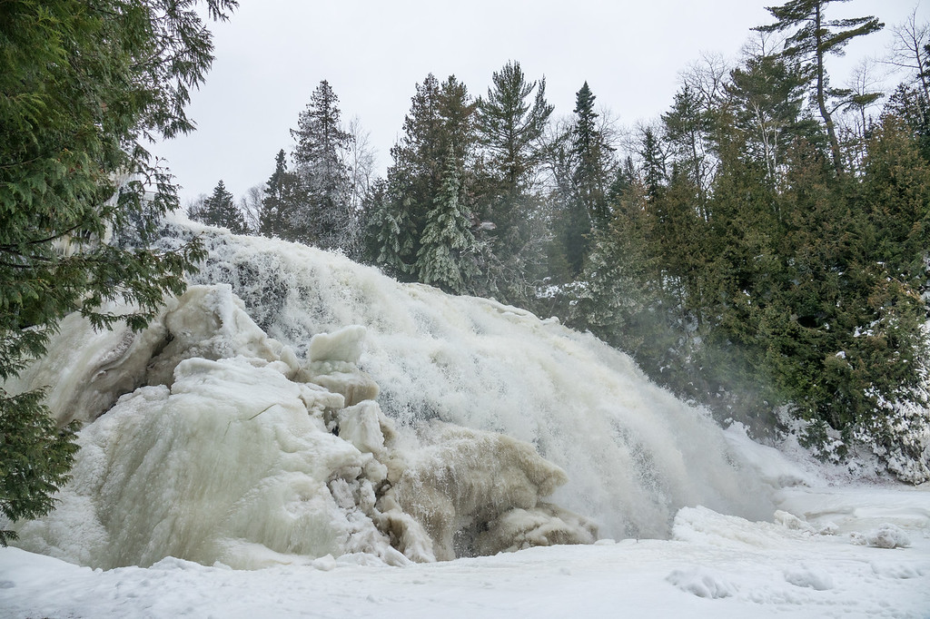 """FRIDAY, JANUARY 27, 2017<br /> <br /> PIGEON RIVER 00205<br /> <br /> """"January Thaw at Partridge Falls""""<br /> <br /> Of course, a bike adventure is always better when there is a cool destination and Partridge Falls makes for a pretty sweet destination!  Again, at the waterfall you can see the results of the warm weather we've been having.  Usually in January this waterfall is a solid wall of ice, with the only running water occurring beneath the ice.  This year, however, the waterfall was almost completely open.  You can see evidence of how well it had been frozen by the thick chunk of ice still remaining on the left.  However, our January thaw took care of the majority of that ice.<br /> <br /> Camera: Sony DSC-RX10M3<br /> Focal Length: 24mm<br /> Exposure Time: 1/500<br /> Aperture: f/4<br /> ISO: 200"""