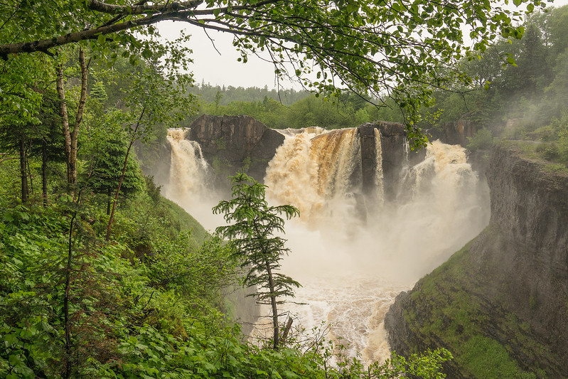 "SATURDAY, JULY 1, 2017<br /> <br /> PIGEON RIVER 04881<br /> <br /> ""High Falls Flow""<br /> <br /> Grand Portage State Park, MN<br /> <br /> Compare the water flow of this photo of High Falls (taken June 30th) to the one I posted yesterday (taken June 23rd).  Quite a bit more water running over the falls now, thanks to several inches of rain in the past week!<br /> <br /> Camera: Sony DSC-RX10M3<br /> Focal Length: 31mm<br /> Exposure Time: 1/500<br /> Aperture: f/4<br /> ISO: 200"
