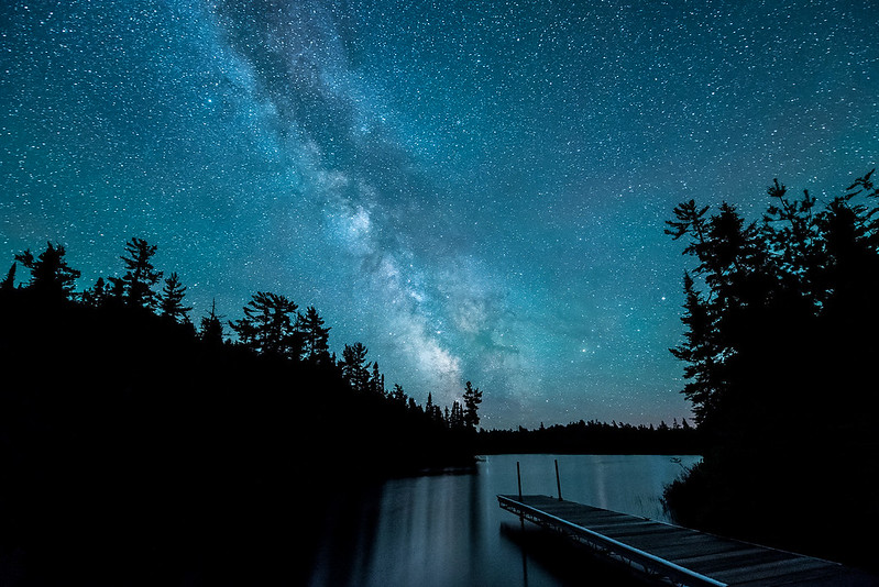 "JULY 31, 2017<br /> <br /> MILKY WAY 5997<br /> <br /> ""Milky Way over Esther Lake""<br /> <br /> Grand Portage State Forest, MN<br /> <br /> There are few pleasures in this world greater than standing under a sky filled with the stars of the Milky Way.  Do yourself a favor, find a dark sky and bask in the glow of the stars.  Star glow is good for the soul.  <br /> <br /> Camera: Nikon D750<br /> Lens: Nikon 14-24mm f/2.8<br /> Focal Length: 14mm<br /> Exposure Time: 30 seconds<br /> Aperture: f/2.8<br /> ISO: 6400"