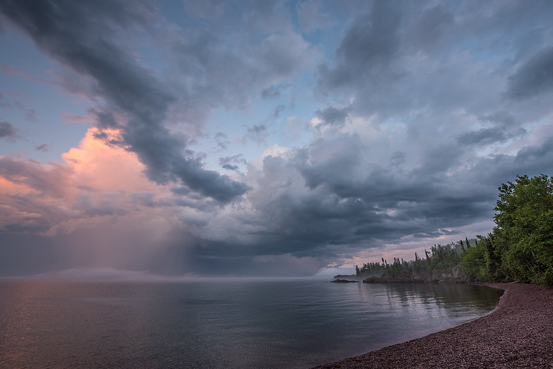 "MONDAY, JULY 10, 2017<br /> <br /> SUPERIOR SUMMER 2900<br /> <br /> ""Rain Squall at Sunset, Red Rock Point""<br /> <br /> After making the photograph of the storm over Hollow Rock Creek, I drove down to the Lake Superior shoreline to catch the storm clouds out over the lake. Red Rock Point ended up being the perfect location for some really cool clouds and some fog floating over the horizon.  <br /> <br /> Camera: Nikon D750<br /> Lens: Nikon 14-24mm f/2.8<br /> Focal Length: 14mm<br /> Exposure Time: 1/25<br /> Aperture: f/8<br /> ISO: 200"