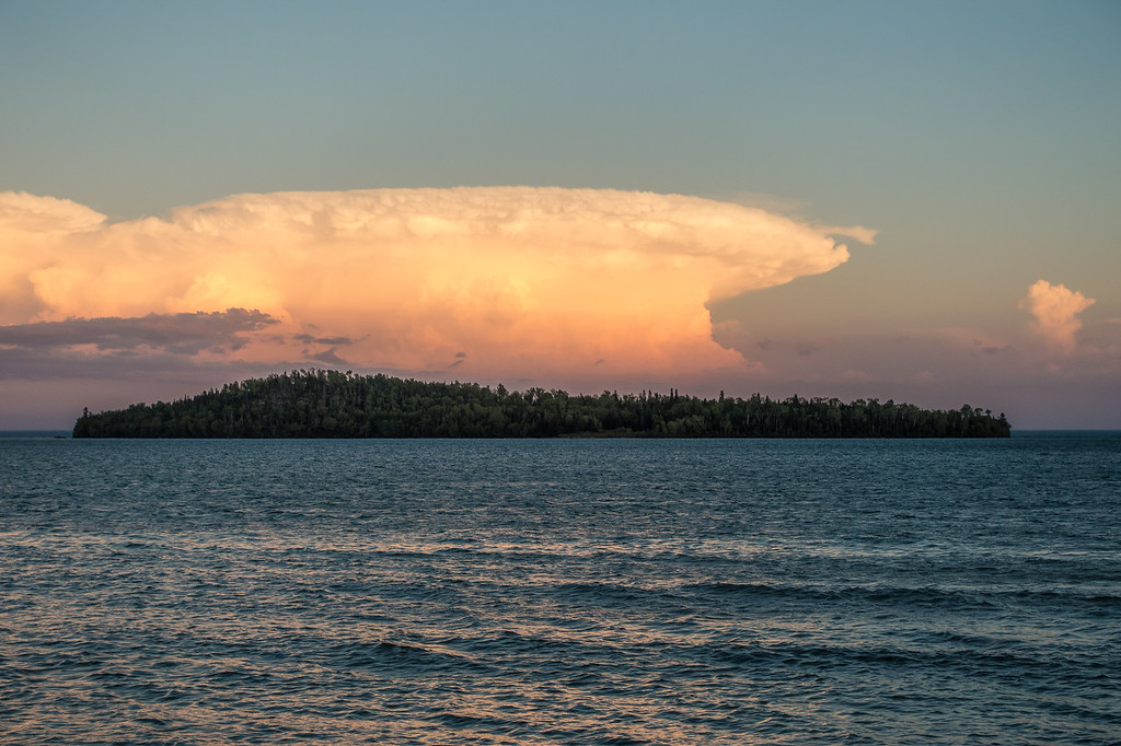 "MONDAY, JUNE 12, 2017<br /> <br /> SUPERIOR SUMMER 05924<br /> <br /> ""Mushroom Cloud over Pete's Island""<br /> <br /> One of the coolest clouds I've ever seen over Lake Superior showed itself behind Pete's Island at sunset on Grand Portage Bay the other day.<br /> <br /> Camera: Sony DSC-RX100M3<br /> Focal Length: 70mm<br /> Exposure Time: 1/250<br /> Aperture: f/4<br /> ISO: 100"