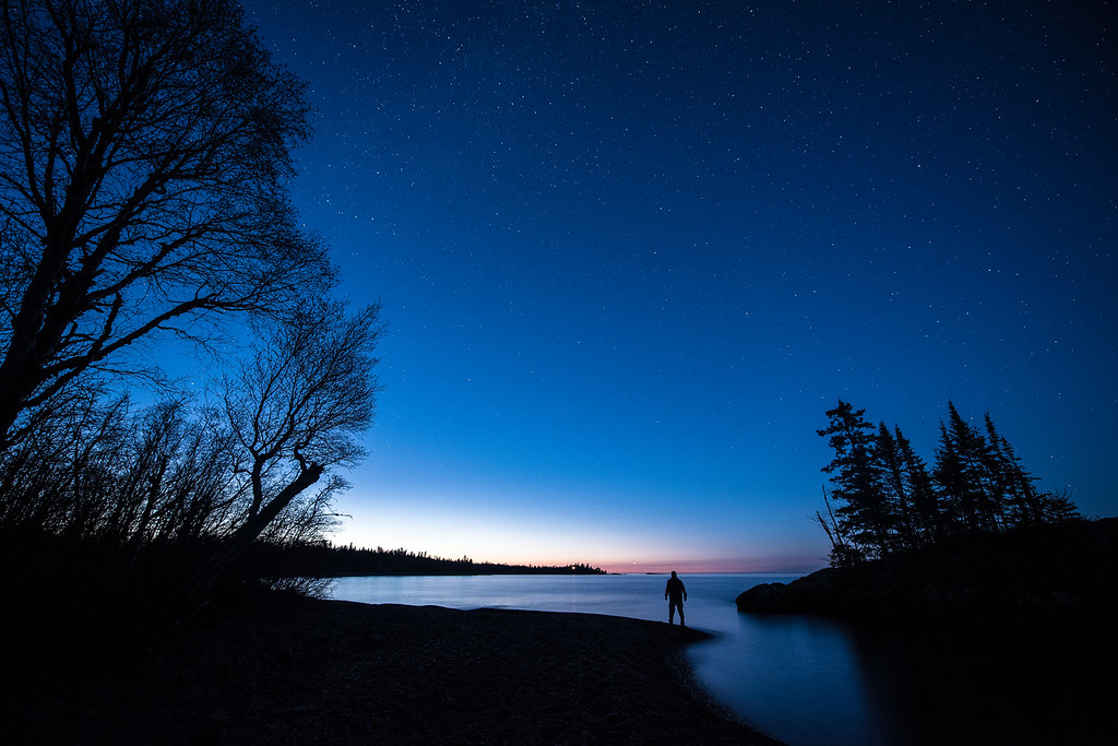 "FRIDAY, JUNE 9, 2017<br /> <br /> SUPERIOR SPRING 2799-2<br /> <br /> ""Early morning on the Superior Hiking Trail""<br /> <br /> About two weeks ago I spent most of the night photographing the stars of the Milky Way over Lake Superior.  It was such a good night for photography that I stayed out until the horizon started to glow with the light of the approaching sun.  I love that time as you can still see quite a few stars in the sky as dawn approaches.  <br /> <br /> Camera: Nikon D750<br /> Lens: Nikon 14-24mm f/2.8<br /> Focal Length: 14mm<br /> Exposure Time: 10 seconds<br /> Aperture: f/2.8<br /> ISO: 1000"