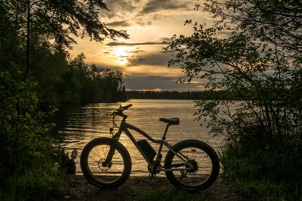 "WEDNESDAY, JUNE 28, 2017<br /> <br /> BIKING 04870<br /> <br /> ""Rad Rover and Sunset on Otter Lake""<br /> <br /> Sunset over Otter Lake last night on my ride with the Rad Rover.<br /> <br /> Cook County, MN<br /> <br /> Camera: Sony DSC-RX10M3<br /> Focal Length: 39mm<br /> Exposure Time: 1/1600<br /> Aperture: f/4<br /> ISO: 100"