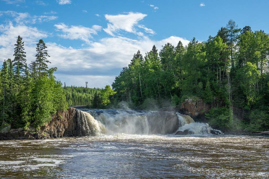"THURSDAY, JUNE 29, 2017<br /> <br /> PIGEON RIVER 04818<br /> <br /> ""Middle Falls of the Pigeon River""<br /> <br /> Grand Portage State Park, MN<br /> <br /> Middle Falls of the Pigeon River, a beautiful little waterfall along the river that forms the boundary between the United States and Canada in northeast Minnesota.  It's a rugged 5 mile round-trip hike to get to this vantage point of the waterfall and this year it's a super muddy hike.  It's been a very wet year so far and the trail hasn't had a chance to dry out, so be prepared to get dirty if you make the hike to Middle Falls!<br /> <br /> Camera: Sony DSC-RX10M3<br /> Focal Length: 56mm<br /> Exposure Time: 1/800<br /> Aperture: f/5.6<br /> ISO: 100"