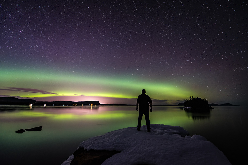 "TUESDAY, MARCH 28, 2017<br /> <br /> AURORA 2187<br /> <br /> ""Aurora Borealis, Sturgeon Bay""<br /> <br /> Ontario, Canada<br /> <br /> Had a blast last night watching the northern lights after going to the movies in Thunder Bay!  I knew the aurora forecast was good so I planned on hiking down to the shoreline of Sturgeon Bay on my way home, with hopes that the lights would be out.  When I first arrived at this location the lights were indeed out, but they were very faint.  My timing was good, however, as not long after I got my camera set up the lights started to get stronger.  Before long there was a full-blown aurora storm going on in front of me!  <br /> <br /> The photo shown here was before the lights got really intense.  I had a timelapse sequence going during the strongest of the lights, so I was able to capture the motion and intensity of the storm on video.  While the sky was going crazy with activity, Lake Superior was exactly the opposite.  It was one of those rare nights where the lake is absolutely still.  Calm enough that you could easily see stars reflecting in the surface of the water.  I stayed at this location for 3 hours hoping the lights would flare up into another storm.  Unfortunately they did not.  After the one big flare-up the activity subsided for the remainder of my time there. With several nice images and a sweet timelapse, I'd say my 3 hours were definitely a success!<br /> <br /> Camera: Nikon D750<br /> Lens: Nikon 14-24mm f/2.8<br /> Focal Length: 14mm<br /> Exposure Time: 30 seconds<br /> Aperture: f/2.8<br /> ISO: 1600"