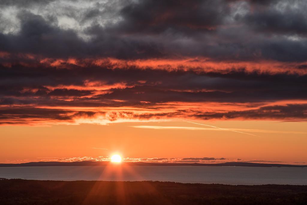 "FRIDAY, OCTOBER 27, 2017<br /> <br /> SUPERIOR FALL 3226<br /> <br /> ""Autumn Sunrise over Isle Royale National Park""<br /> <br /> A recent beautiful sunrise over Isle Royale National Park on Lake Superior, taken from Grand Portage, Minnesota.  <br /> <br /> Camera: Nikon D750<br /> Lens: Nikon 24-120mm f/4<br /> Focal Length: 120mm<br /> Exposure Time: 1/25<br /> Aperture: f/22<br /> ISO: 100"