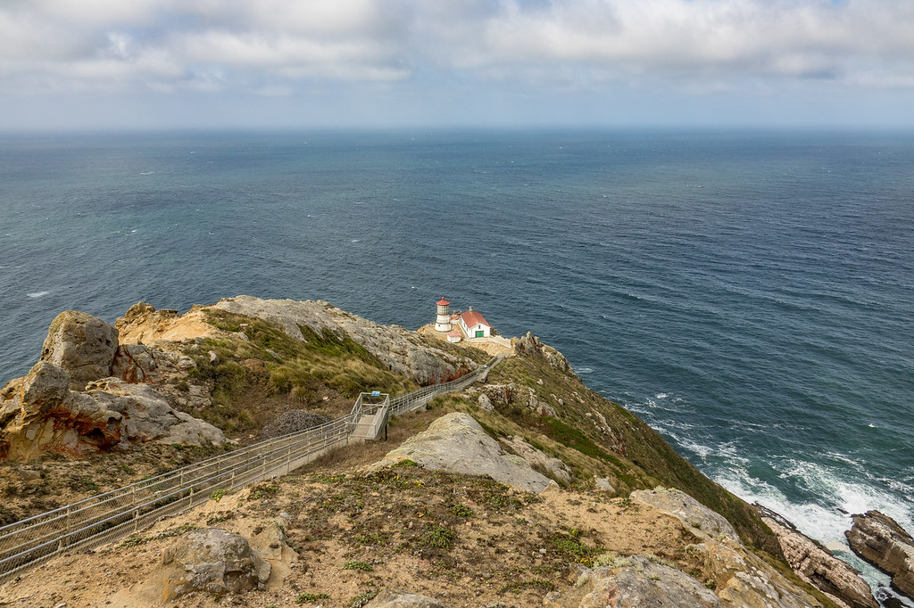 "MONDAY, SEPTEMBER 25, 2017<br /> <br /> CALIFORNIA 05927<br /> <br /> ""Point Reyes Lighthouse""<br /> <br /> Point Reyes National Seashore has one of the most fascinating lighthouse locations I've seen.  Unfortunately the lighthouse was closed the day we visited and we were unable to walk down the steps to see it up close.  No matter, it still looked cool from way up on the hill!  The lighthouse was first lit on December 1, 1870 and was automated in 1975.  The location is frequently blanketed by week-long periods of fog and few years pass that do not see gales of 75 to 100 miles per hour strike the area.  <br /> <br /> Camera: Sony DSC-RX10M3<br /> Focal Length: 24mm<br /> Exposure Time: 1/320<br /> Aperture: f/5.6<br /> ISO: 100"