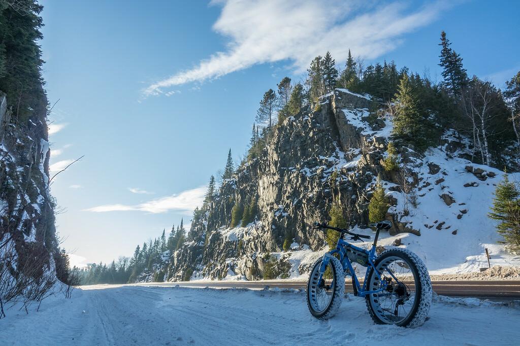 """Biking through the Mt. Josephine rock cut"""