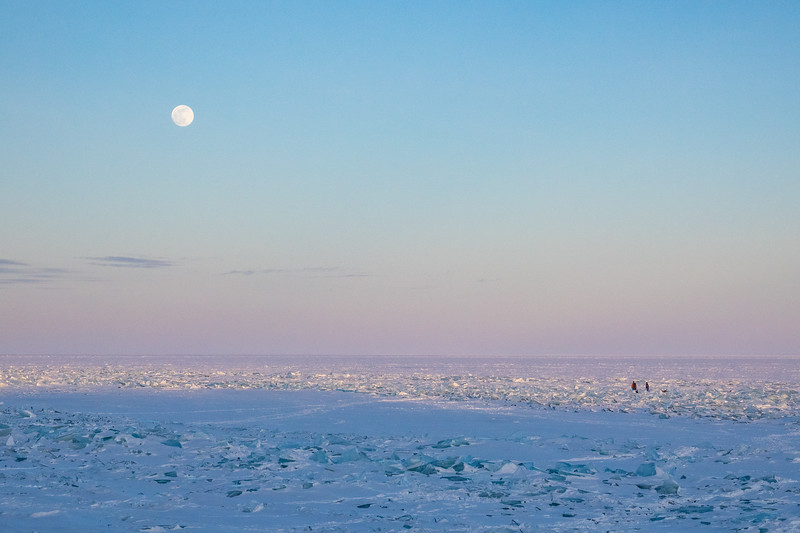 """Watching the moon rise over the Lake Superior ice"""