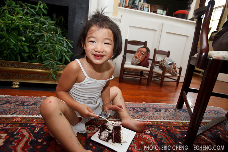 Kira dives into her piece of chocolate cake