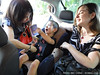 Livia and Alisa help Jack into his car seat