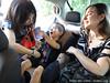 Livia and Alisa help Jack into his car seat