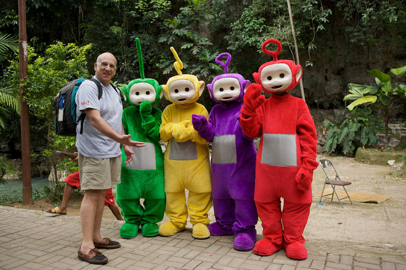 Steve Drogin with teletubbies in Ujung Pandang, Indonesia. December 5, 2004.  Photo: Eric Cheng