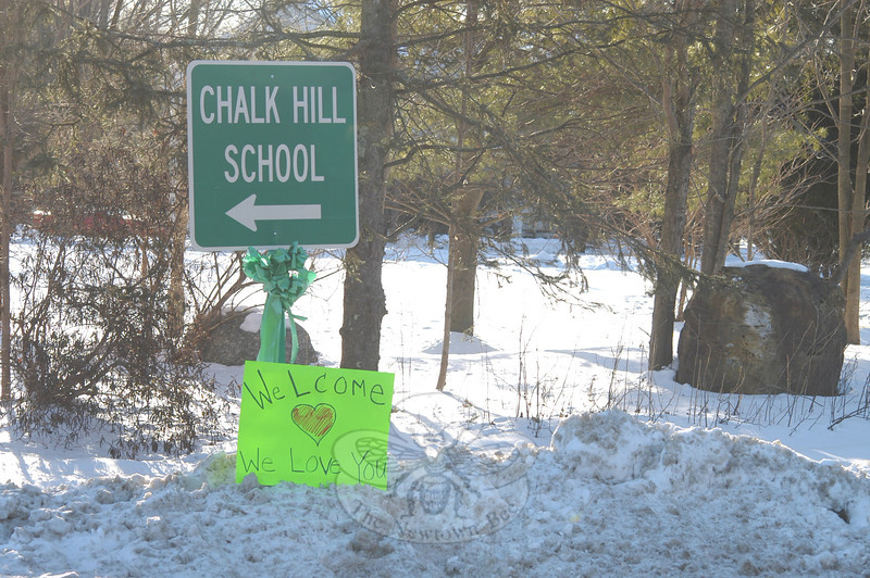 On their way to Chalk Hill School Wednesday morning, Sandy Hook School students saw signs of encouragement along the way. (Hutchison photo)